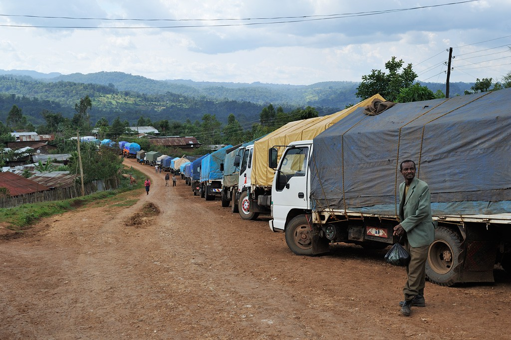 Queue of coffee laden trucks in front of the ECX