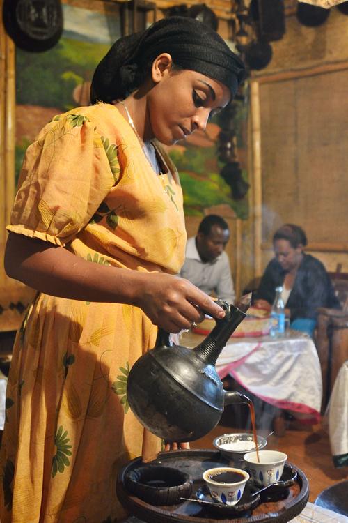 "Fresh brewed coffee with an Ethiopian coffee pot ""Jebena"""